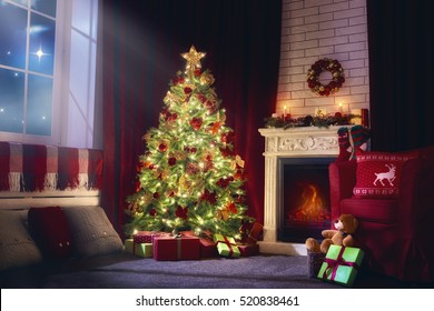 Merry Christmas and Happy Holidays! A beautiful living room decorated for Xmas. Christmas family traditions.