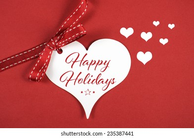 Yuletide season greetings stock images royalty free images merry christmas happy holidays greeting on white heart gift tag on red background with sample m4hsunfo