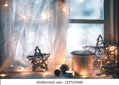 Merry Christmas and happy holidays Window with a cup of hot drink,new year decoration.