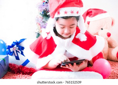 Merry Christmas and happy holidays,girl sitting in room decorated on Christmas. enjoy on holiday concept..girl with presents around the Christmas tree.