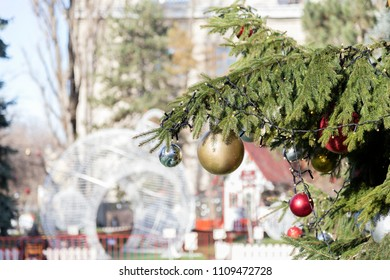 Merry Christmas and Happy New Year. Ornate bough of the urban new year tree in the blurred background.