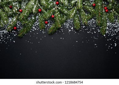 Merry christmas and happy new year. Holiday background with copy space for text. Decor with fir branches and holly berries in snow. Flat lay, top view