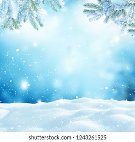 Merry Christmas and happy New Year greeting card with copy-space.Winter landscape with snow and fir trees branch