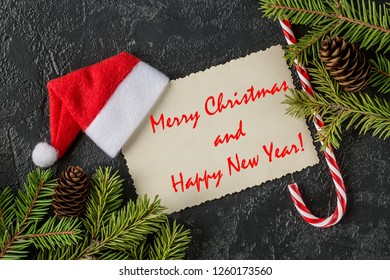 Merry Christmas and happy new year greetings postcard. Winter holiday composition. New Year and Christmas celebration. Winter holidays concept. Christmas decorations. Top View.