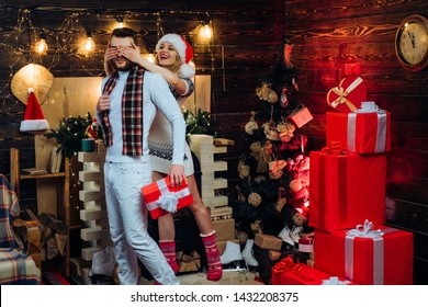 Merry christmas and happy new year. Christmas gifts. Man handsome with gift box surprise for girlfriend. Man hipster give gift to girl christmas decorations. Guess who. Surprise for sweetheart.