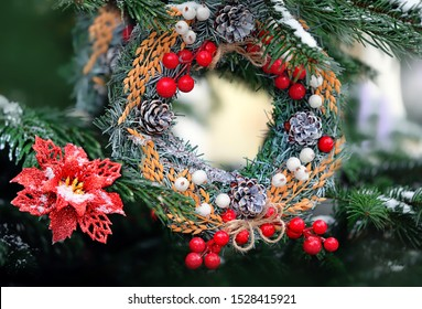 merry Christmas and happy New Year  concept. Traditional Christmas wreath, poinsettia christmas, beautiful festive decor. winter holiday bright background. copy space