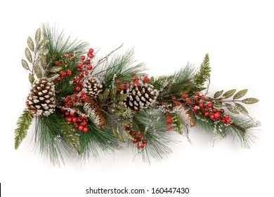 Merry Christmas and Happy New Year. A Christmas garland made from conifer sprigs with red berries  and pine cones on a white background.