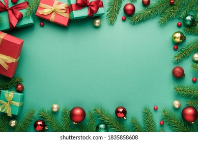 Merry Christmas and Happy New Year frame on turquoise background. Top view, flat lay with copy space for text - Shutterstock ID 1835858608