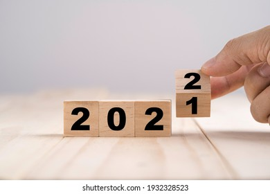 Merry Christmas and happy new year concept, Flipping of wooden cube block change from 2021 to 2022.
