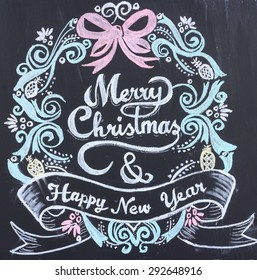 Merry Christmas Happy New Year Drawing on blackboard