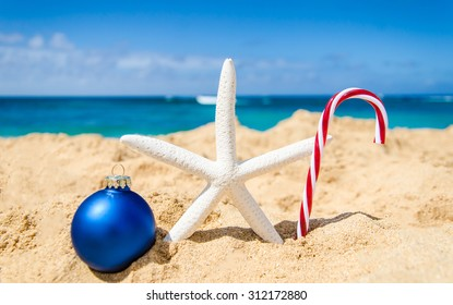 merry christmas and happy new year background with starfish and ball on the tropical beach near