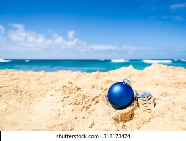 merry christmas and happy new year background with gift and ball on the tropical beach near