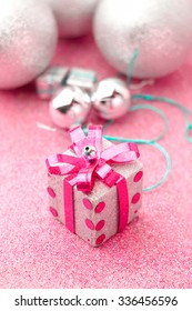 Merry Christmas and Happy New Year box gift with glitter background