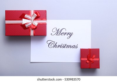 Merry christmas and happy new year card, gift box, ball with red decoration
