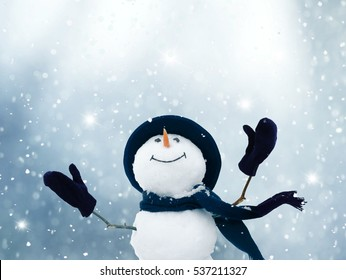 Merry Christmas and happy New Year greeting card .Happy snowman standing in winter  landscape.Snow background.