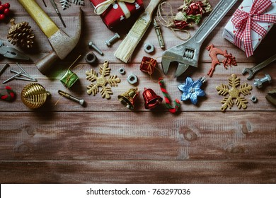 Merry christmas and Happy New year with handy tools  background concept, Used old rusty constructor tools with Christmas decoration on wood