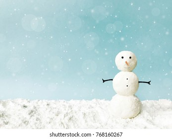 Merry christmas and happy new year greeting card with copy space. Snowman on snow background.