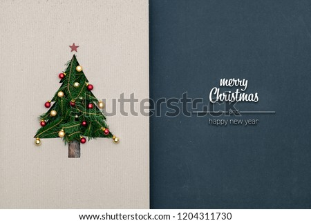 merry christmas and happy new year greetings in vertical top view dark blackboard with natural eco