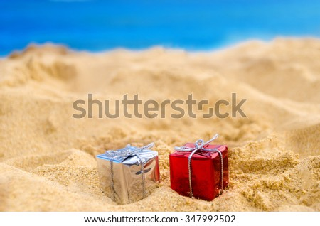 merry christmas and happy new year background holidays gift on the tropical beach near ocean