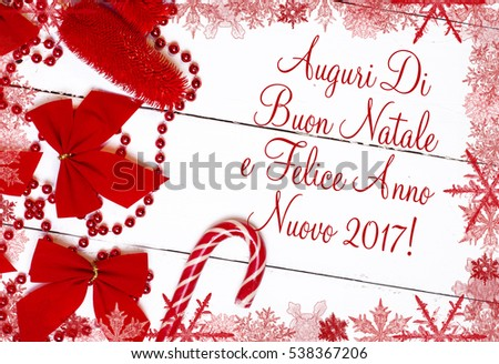 merry christmas and happy new year in italian language text card surrounded by a red frame