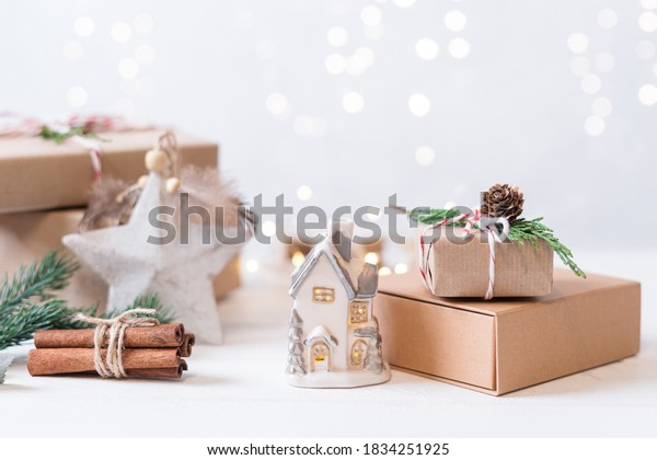 Merry Christmas and Happy New Year on white background. Holidays greeting card. Christmas lights and decoration with wrapping gifts. Selective focus