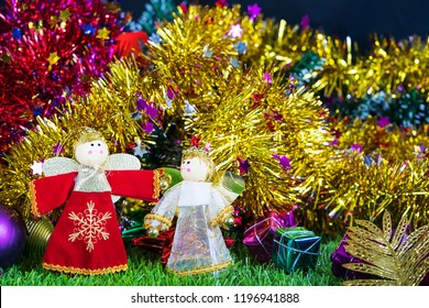 Merry Christmas and Happy New year,Holiday decoration and doll on green grass