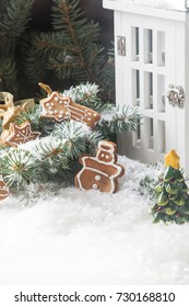 Merry christmas holiday decoration background with ginger man snowflakes snowman and tree cookies dry orange. Light wooden table. Space for text