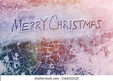MERRY CHRISTMAS inscription at the top of the image, the snow and ice background