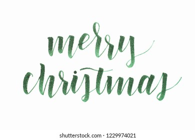 Merry Christmas lettering isolated on white background. Handwritten text for holidays.