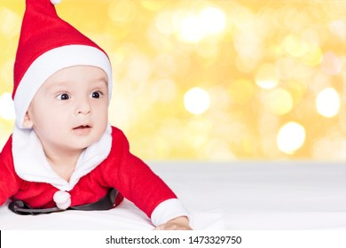 Merry christmas from Little Santa. 6-9 months old baby boy worn in costume of Santa Claus. Copy space, Free space or Free space for text and ads.