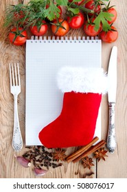 Merry Christmas menu card.Tomatoes, garlic, parsley and spices on the wooden background with space for text. Top view.