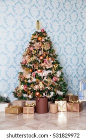 Merry christmas and new year background. Classic green tree decorated with presents under