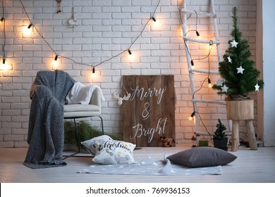Merry christmas and new year brick wall background. white decor. Loft style