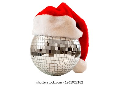 Merry Christmas and new year eve party poster concept with a shiny disco ball covered in mirror glass wearing a Santa hat isolated on white background with clip path cutout