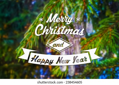 Merry Christmas and New Year greeting card on blurred green spruce or fir-tree branches background