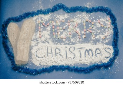 Merry Christmas on a blue background