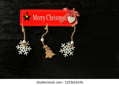 Merry christmas ornament on wooden table