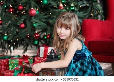 Merry Christmas. Pretty young girl near Christmas tree
