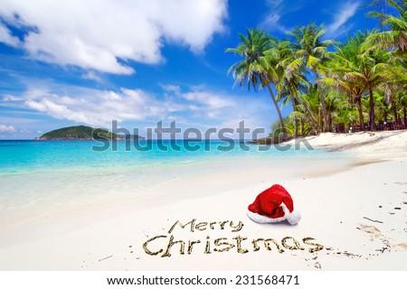 merry christmas with santa hat from the tropical beach - Merry Christmas Beach