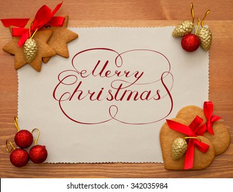 Merry christmas sign over old paper and christmas decorations
