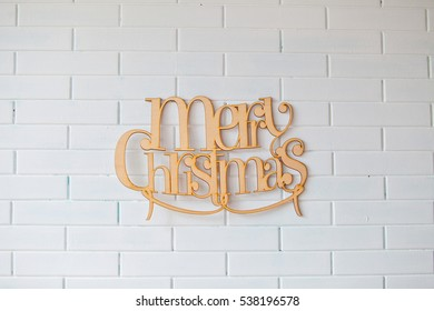 MERRY CHRISTMAS text on rustic white brick wall background