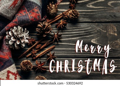 Merry Christmas Text Sign Greeting On Stylish Rustic Winter Or Autumn Wallpaper With Anise Cinnamon And
