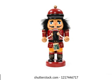 Merry Christmas: Traditional colorful vintage wooden nutcracker little drummer boy doll puppet isolated on white background and copyspace for text - concept festive Christmas decoration ornament