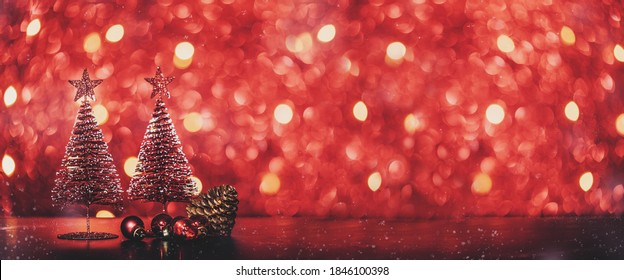 Merry Christmas tree and happy new year background on red glitter sparkling string lights festive bokeh background.holiday celebration greeting card