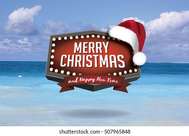 Merry Christmas from a tropical climate or from the beach. With retro Christmas marquee sign and Santa Claus hat.