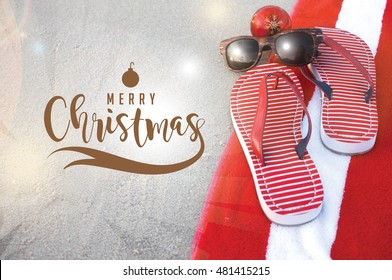 Merry Christmas from a tropical climate. Flip flops on the beach. For Christmas in June, July, August, December. Christmas card with copy space.