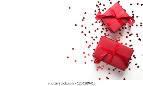 Merry Christmas, Valentine's day and Happy Holidays greeting card, frame, banner. New Year. Christmas red gifts, presents on white background top view. Winter holiday love theme. Birthday. Flat lay.