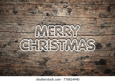 MERRY CHRISTMAS word on old wooden table