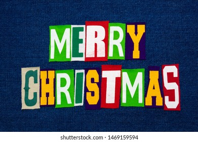Merry Christmas word text collage typography, multi colored fabric on blue denim, winter holiday, horizontal aspect