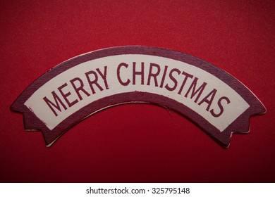 Merry Christmas words on banner over red background